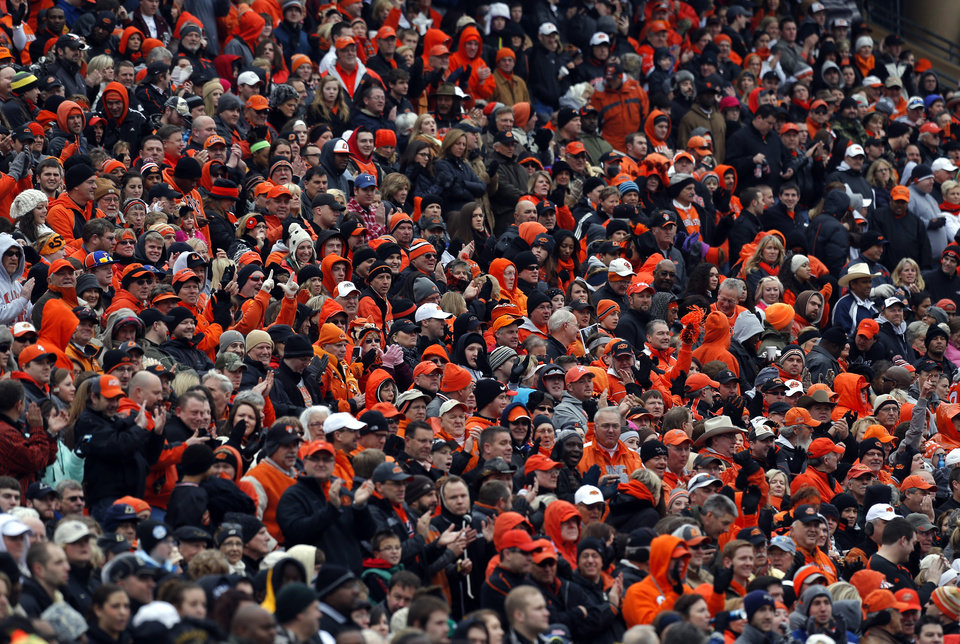 Photo - OSU fans watch the game during the Heart of Dallas Bowl football game between the Oklahoma State University (OSU) and Purdue University at the Cotton Bowl in Dallas,  Tuesday,Jan. 1, 2013. Photo by Sarah Phipps, The Oklahoman