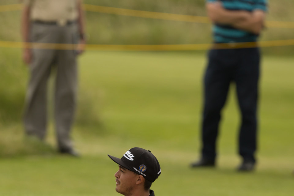 Photo - Rickie Fowler of the US stands in bunker by the 6th green during a practice round at Royal Liverpool Golf Club prior to the start of the British Open Golf Championship, in Hoylake, England, Monday, July 14, 2014. The 2014 Open Championship starts on Thursday, July 17. (AP Photo/Jon Super)