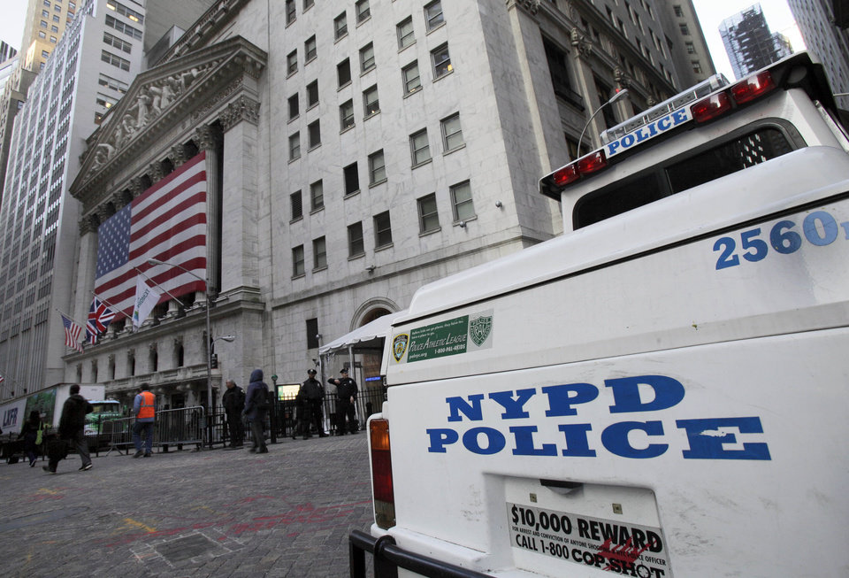 Photo -   A New York City Police Department vehicle is parked near the New York Stock Exchange, Thursday morning, Oct. 18, 2012. A Bangladeshi man, 21-year-old Quazi Mohammad Rezwanul Ahsan Nafis, snared in an FBI terror sting, considered targeting a high-ranking government official and the New York Stock Exchange before authorities say he raised the bar further by picking one of New York City's most fortified sites: The Federal Reserve. (AP Photo/Richard Drew)