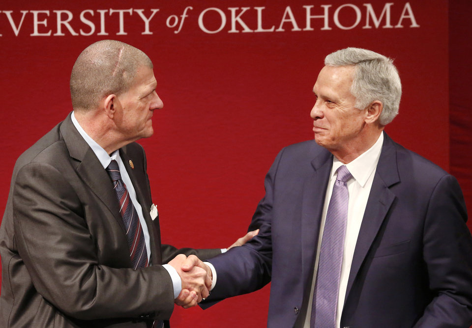 Photo - Regents chairman Clay Bennett, left, shakes the hand of fellow regent Kirk Humphreys at the end of the meeting on Thursday, Dec. 21, 2017, when the embattled regent Humphreys announced he is resigning from the University of Oklahoma Board of Regents effective with the beginning of the spring semester. Humphreys made the announcement Thursday after board members met behind closed doors for two hours. He was appointed a regent by Gov. Mary Fallin in 2012. As vice chairman, Humphreys was to be next in line for the chairman position. The board currently is chaired by Clay Bennett, businessman and chairman of the Oklahoma City Thunder.  The board met in the Robert M. Bird Library on the campus of the OU Health Sciences Complex in Oklahoma City. Humphreys also is a former mayor of Oklahoma City.  Photo by Jim Beckel, The Oklahoman