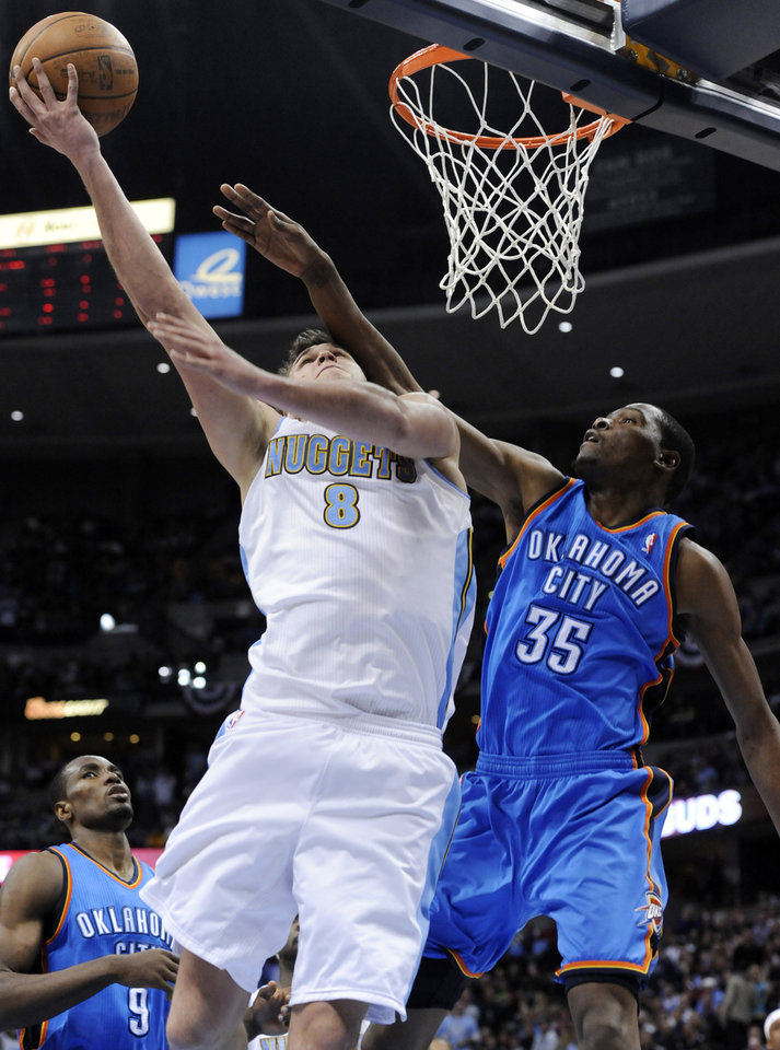 Denver Nuggets forward Danilo Gallinari (8) from Italy goes up for a shot against Oklahoma City Thunder forward Kevin Durant (35) during the second half in game 4 of a first-round NBA basketball playoff series Monday, April 25, 2011, in Denver. Denver beat Oklahoma 104-101. Oklahoma City leads the series 3-1. (AP Photo/Jack Dempsey)