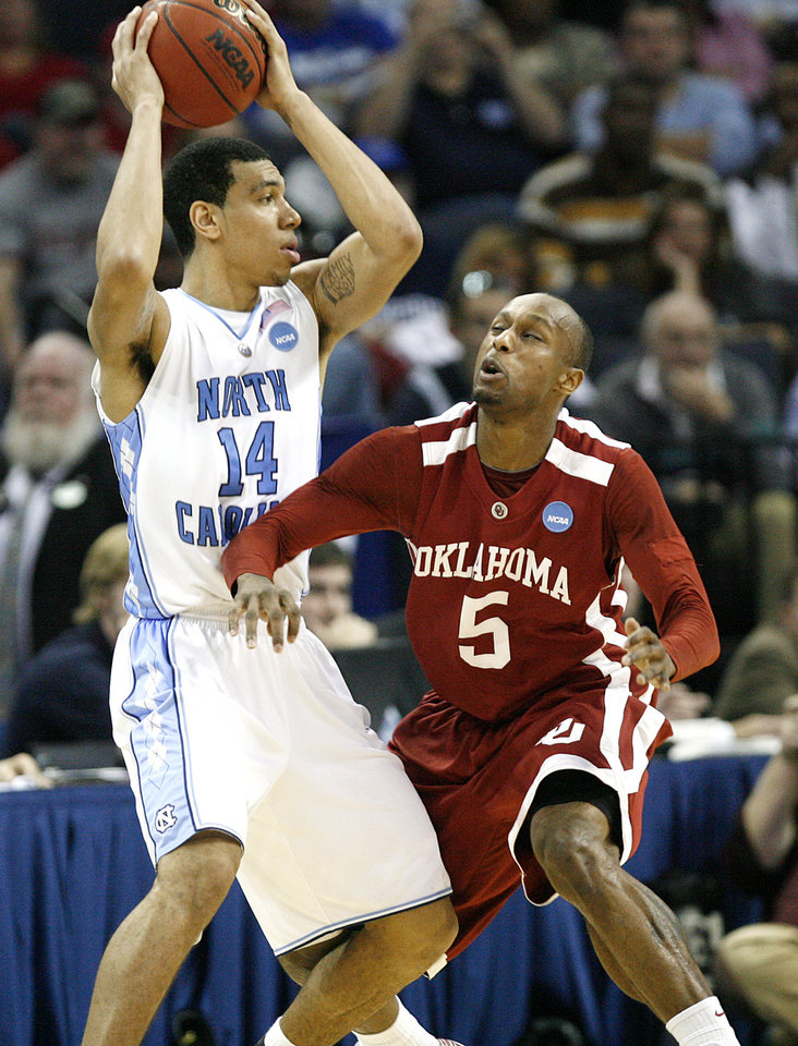 Photo - Oklahoma's Tony Crocker (5) fouls North Carolina's Danny Green (14) during the second half in the Elite Eight game of NCAA Men's Basketball Regional between the University of North Carolina and the University of Oklahoma at the FedEx Forum on Sunday, March 29, 2009, in Memphis, Tenn.