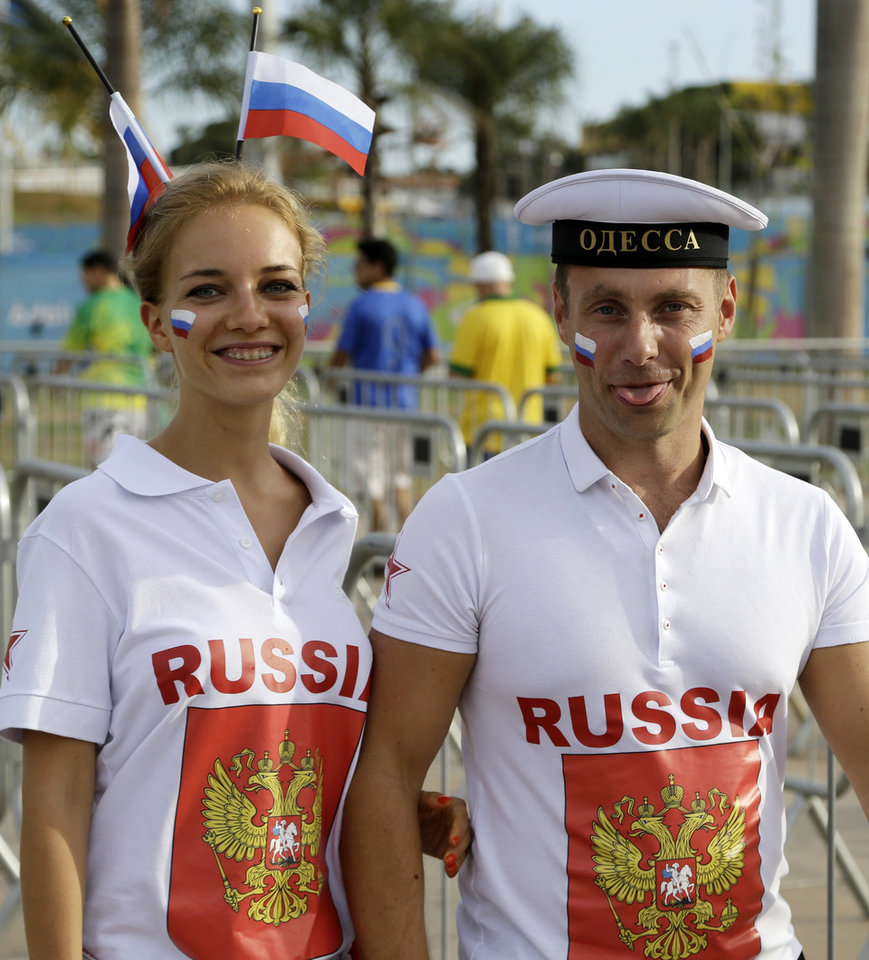 Photo - A couple of fans of the Russian national soccer team pose for a picture as they arrive to the Arena Pantanal before the group H World Cup soccer match between Russia and South Korea in Cuiaba, Brazil, Tuesday, June 17, 2014. (AP Photo/Thanassis Stavrakis)