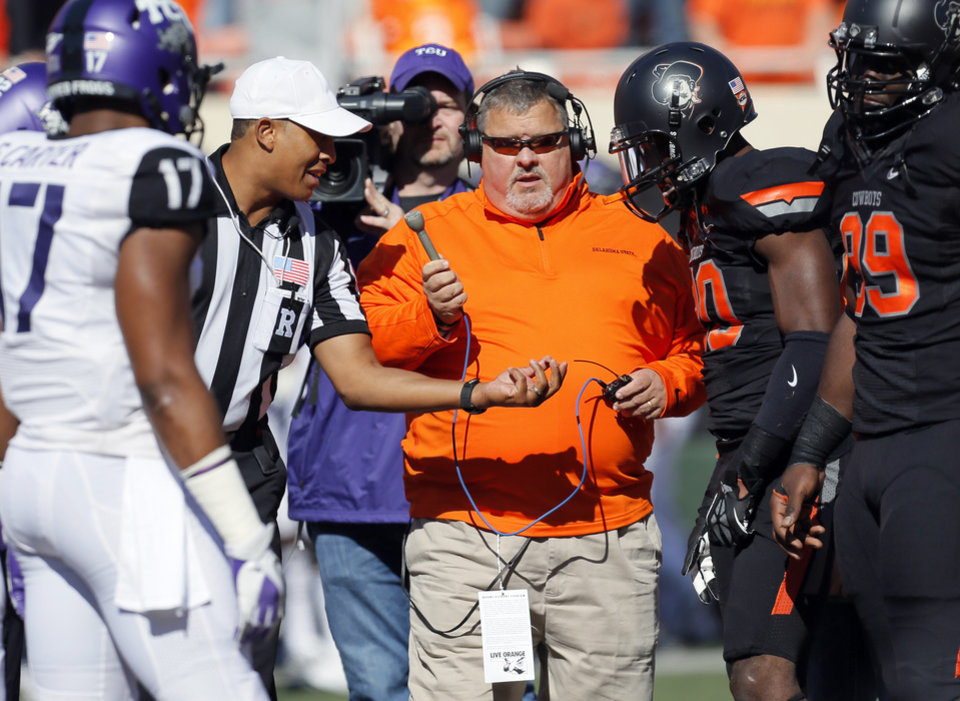 Radio broadcaster Robert Allen records the coin flip before a college football game between Oklahoma State University (OSU) and Texas Christian University (TCU) at Boone Pickens Stadium in Stillwater, Okla., Saturday, Oct. 27, 2012. Photo by Nate Billings, The Oklahoman