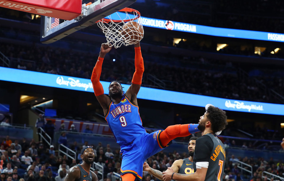 Photo - Jan 22, 2020; Orlando, Florida, USA; Oklahoma City Thunder center Nerlens Noel (9) dunks against the Orlando Magic during the first half at Amway Center.  [Kim Klement/USA TODAY Sports]