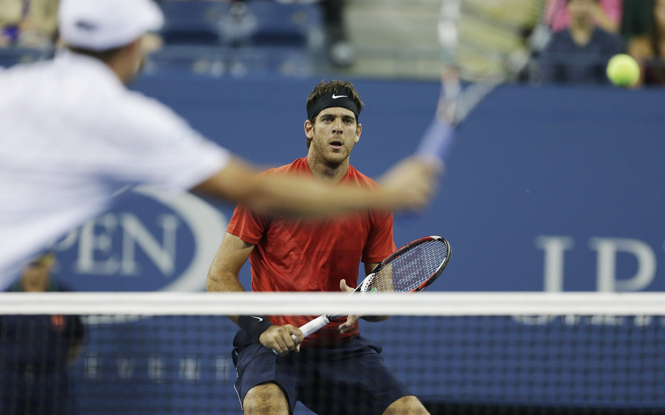Photo -   Juan Martin Del Potro of Argentina, right, waits at the net for a return shot by Andy Roddick in the fourth round of play at the 2012 US Open tennis tournament, Tuesday, Sept. 4, 2012, in New York. (AP Photo/Darron Cummings)