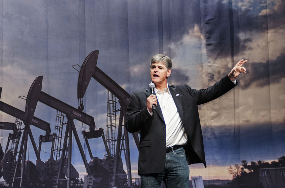 Photo - Political commentator Sean Hannity addresses the crowd during his speech,