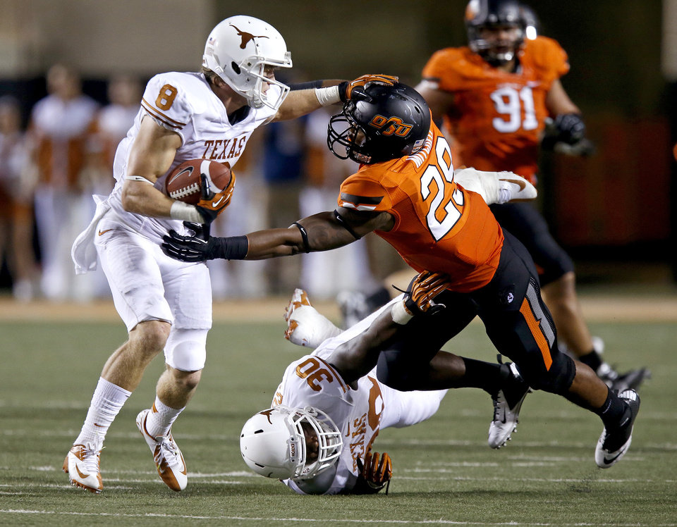 Texas\' Jaxon Shipley (8) fights of Oklahoma State\'s Joe Mitchell (29) during a college football game between Oklahoma State University (OSU) and the University of Texas (UT) at Boone Pickens Stadium in Stillwater, Okla., Saturday, Sept. 29, 2012. Oklahoma State lost 41-36. Photo by Bryan Terry, The Oklahoman