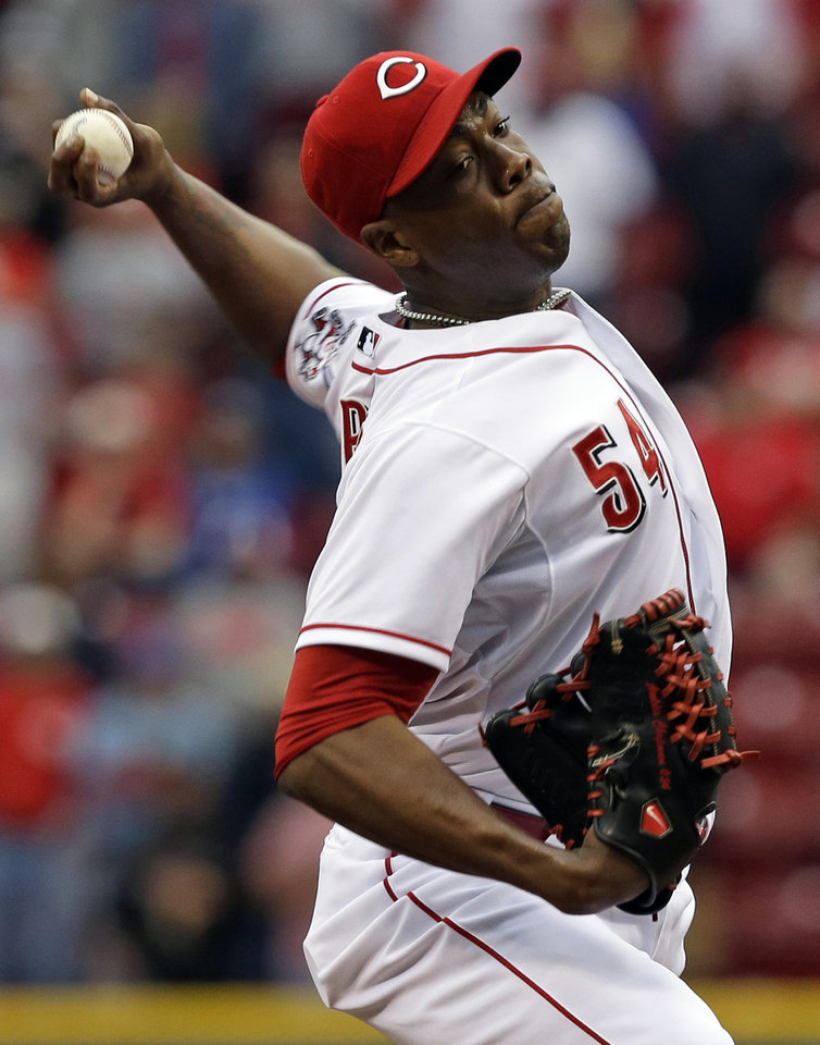 Photo - Cincinnati Reds relief pitcher Aroldis Chapman throws against the Chicago Cubs in the ninth inning of a baseball game on Saturday, May 25, 2013, in Cincinnati. Chapman picked up his 12th save as the Reds won 5-2. (AP Photo/Al Behrman)