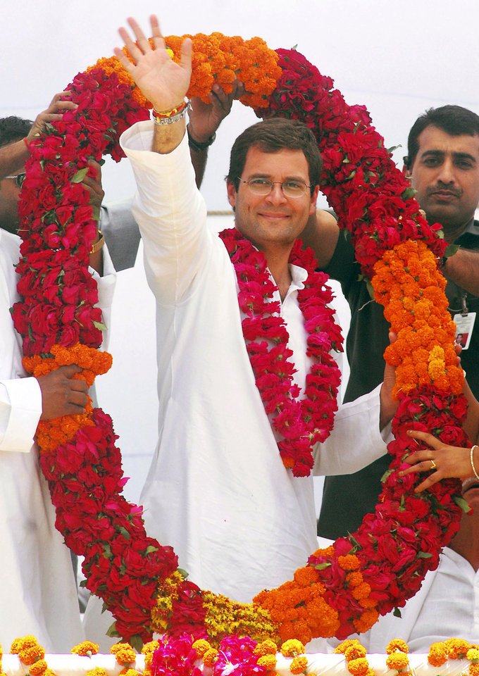 FILE � In this April 18, 2009 file photo, Congress party General Secretary Rahul Gandhi waves to the crowd as he is felicitated by party workers with a garland during an election rally in Amethi, India.   Gandhi was appointed Vice President of the party at a special two-day long party seminar on Saturday, Jan. 19, 2013. (AP Photo/Manish A., File)