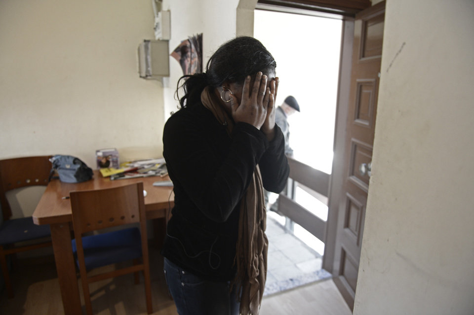 Cynthia Odigie reacts before her eviction in Barcelona, Spain, Thursday, Nov. 15, 2012. The Spanish government on Thursday passed a decree suspending evictions of the most vulnerable homeowners unable to pay their mortgage, a bid to ease a trend that has seen hundreds of thousands of people lose their homes because of the brutal economic crisis. The eviction was finally suspended. (AP Photo/Manu Fernandez)