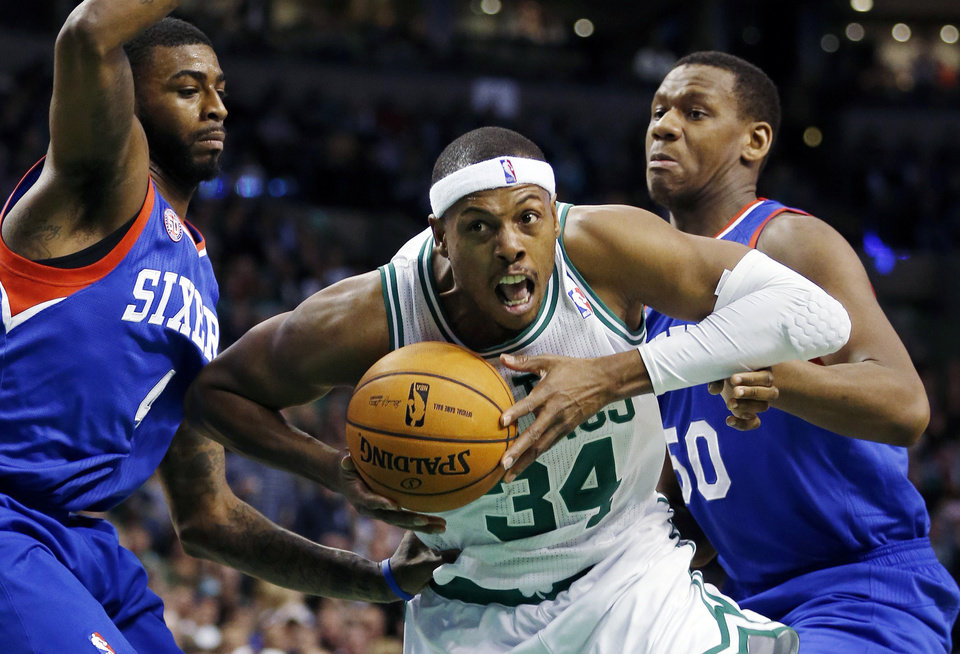 Boston Celtics' Paul Pierce (34) drives for the basket between Philadelphia 76ers' Dorell Wright, left, and Lavoy Allen during the second quarter of an NBA basketball game in Boston, Friday, Nov. 9, 2012. (AP Photo/Michael Dwyer)