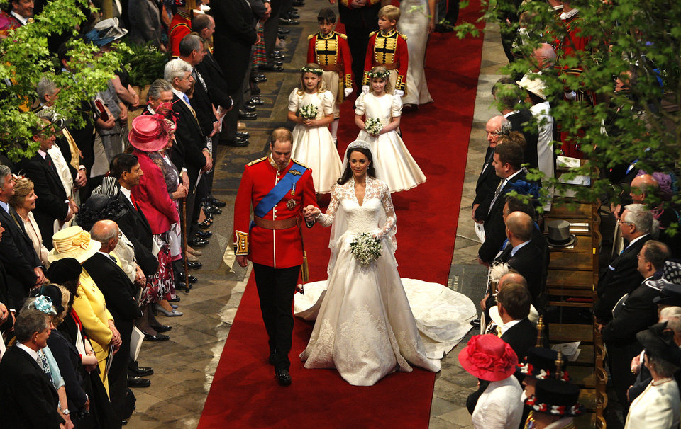 Photo - FILE - This April 29, 2011 file photo shows Prince William and Catherine, the Duchess of Cambridge, walking down the aisle at Westminster Abbey following their marriage in central London. Sony Electronics and the Nielsen television research company collaborated on a survey ranking TV's most memorable moments. Other TV events include, the Sept. 11 attacks in 2001, Hurricane Katrina in 2005, the O.J. Simpson murder trial verdict in 1995 and the death of Osama bin Laden in 2011.  (AP Photo/RICHARD POHLE, Pool) ORG XMIT: NYET128