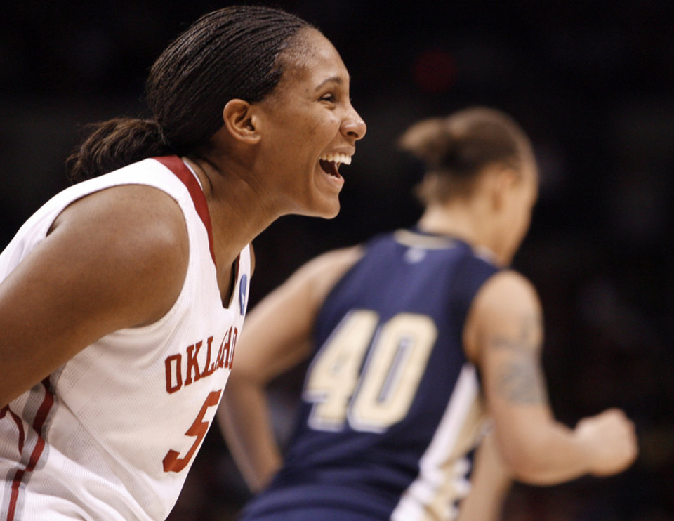 Photo - Ashley Paris celebrates in the second half of the NCAA women's basketball tournament game between the University of Oklahoma and Pittsburgh at the Ford Center in Oklahoma City, Okla. on Sunday, March 29, 2009. 