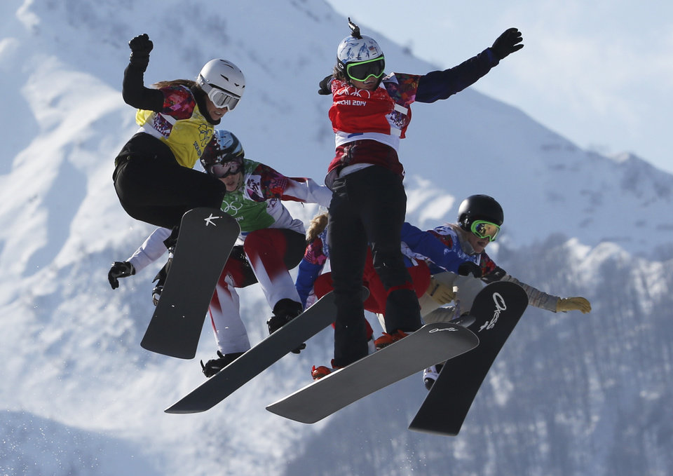 Photo - Czech Republic's Eva Samkova, second right, leads the field in the women's snowboard cross final at the Rosa Khutor Extreme Park, at the 2014 Winter Olympics, Sunday, Feb. 16, 2014, in Krasnaya Polyana, Russia. Samkova went on to win the gold medal. The other boarders are, from left, Bulgaria's Alexandra Jekova, Canada's Dominique Maltais, France's Chloe Trespeuch (obscured), and United States' Faye Gulini. (AP Photo/Luca Bruno)