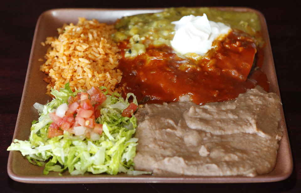 Photo - Flat enchilada dinner at the Green Chili Kitchen in Yukon, Friday  January  11, 2013. Photo By Steve Gooch, The Oklahoman