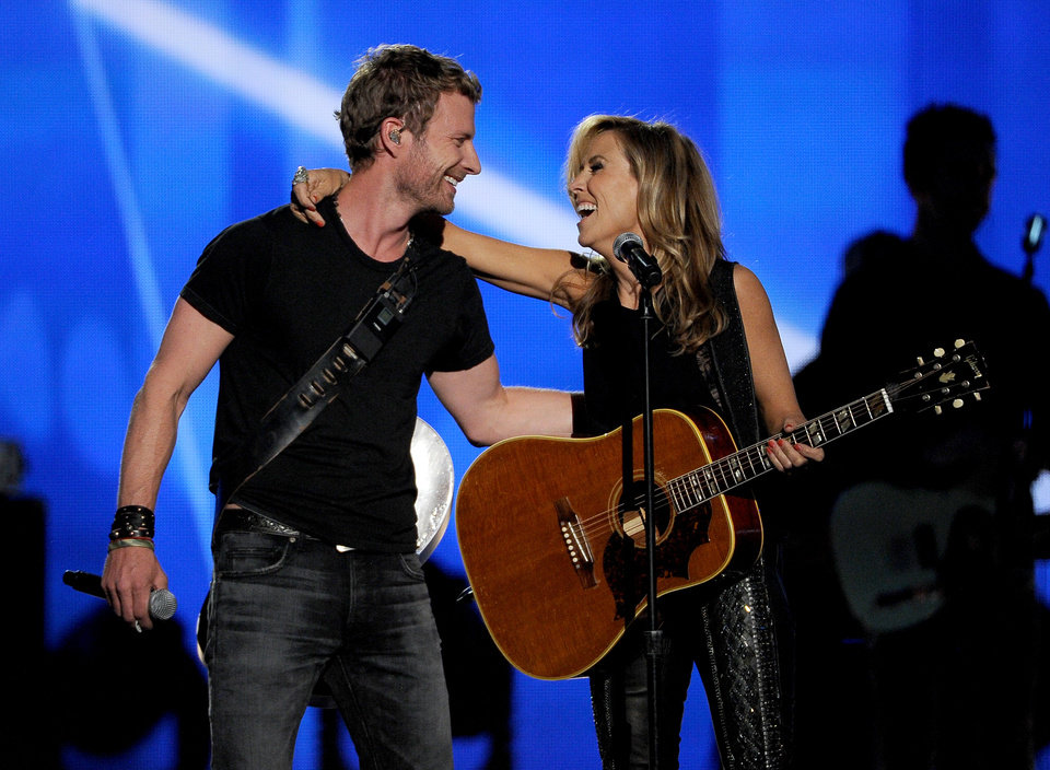 Photo - Dierks Bentley, left, and Sheryl Crow perform on stage at the 49th annual Academy of Country Music Awards at the MGM Grand Garden Arena on Sunday, April 6, 2014, in Las Vegas. (Photo by Chris Pizzello/Invision/AP)
