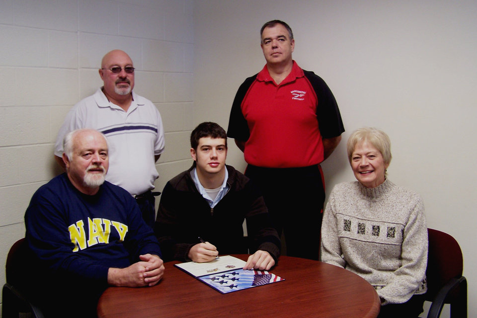 Tyler Simmons, Washington High School, signed to play football with the U.S. Naval Academy on February 7, 2007.  Pictured(seated L-R), father, Bob Simmons, Tyler Simmons, mother, Linda Simmons; standing Coach Emmitt Canfield and Head Coach Dennis McCray<br/><b>Community Photo By:</b> LuGlena Moore<br/><b>Submitted By:</b> LuGlena, Washington