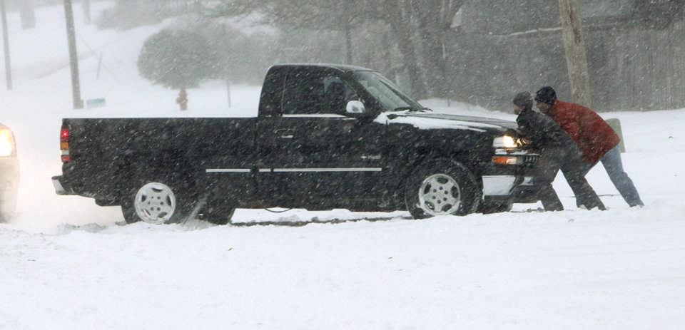 Photo - Motorists attempt to get a pickup truck out of a snow drift on N. Bryant Ave. in Edmond, OK, Tuesday, Feb. 1, 2011. By Paul Hellstern, The Oklahoman