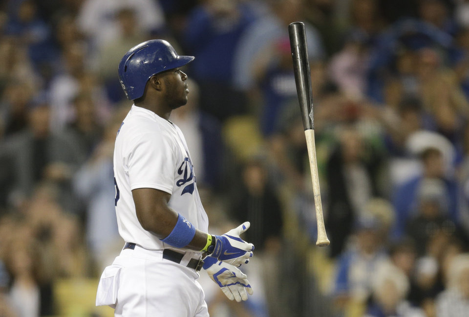 Photo - Los Angeles Dodgers' Yasiel Puig tosses his bat after swinging on a pitch during the fifth inning of a baseball game against the Pittsburgh Pirates on Friday, May 30, 2014, in Los Angeles. (AP Photo/Jae C. Hong)