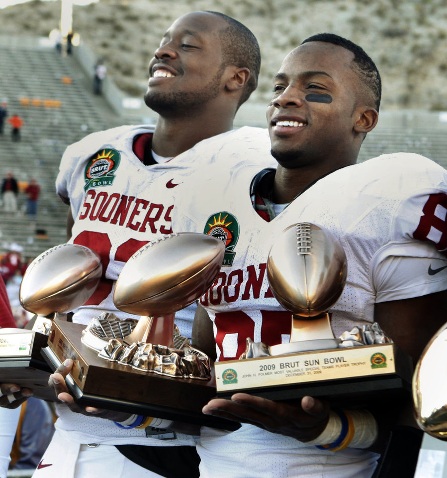 Photo - Gerald McCoy, defensive lineman of the game, and Ryan Broyles, player of the game hold a collection of trophies after their 31-27 victory at the Brut Sun Bowl college football game between the University of Oklahoma Sooners (OU) and the Stanford University Cardinal on Thursday, Dec. 31, 2009, in El Paso, Tex.   Photo by Steve Sisney, The Oklahoman