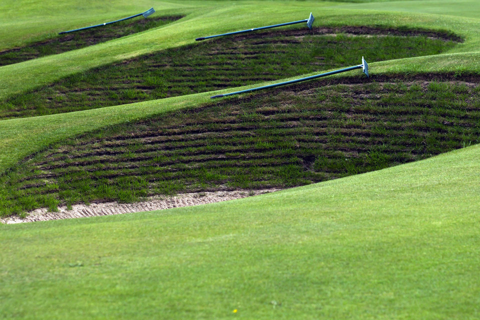Photo - FILE - This April 23, 2014, file photo, shows the bunkers by the 18th green at Royal Liverpool Golf Club before the British Open golf championships in Hoylake, England. The British Open golf championship begins on Thursday July 17, 2014. (AP Photo/Jon Super, File)