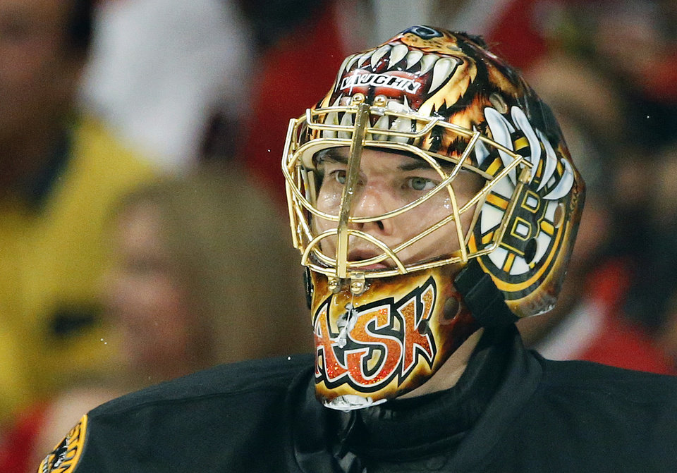 Photo - Boston Bruins goalie Tuukka Rask (40) reacts as he watches play down the ice against the Chicago Blackhawks in the third period during Game 2 of the NHL hockey Stanley Cup Finals, Saturday, June 15, 2013, in Chicago. (AP Photo/Nam Y. Huh)