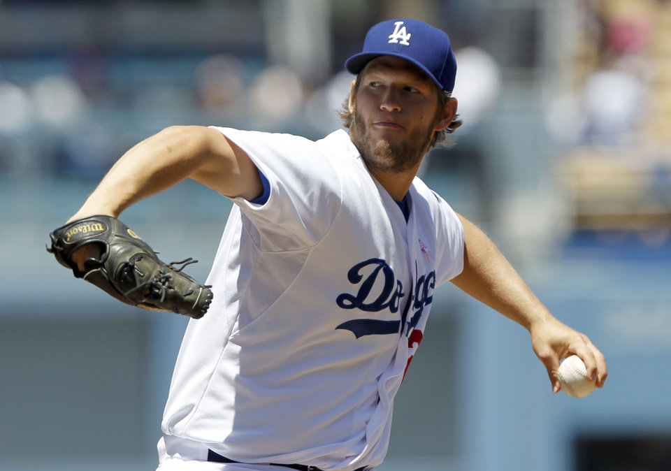 Photo - Los Angeles Dodgers starting pitcher Clayton Kershaw throws against the San Francisco Giants in the first inning of a baseball game on Sunday, May 11, 2014, in Los Angeles. (AP Photo/Alex Gallardo)