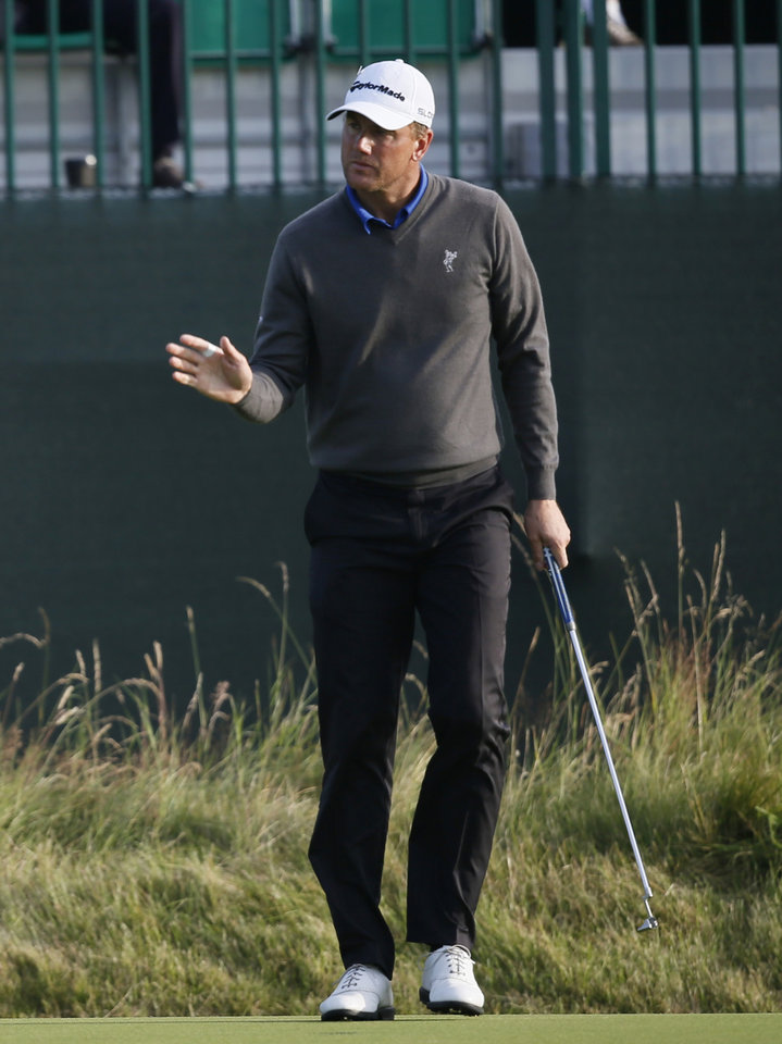 Photo - Robert Karlsson of Sweden prepares to putt on the 3rd green during the first day of the British Open Golf championship at the Royal Liverpool golf club, Hoylake, England, Thursday July 17, 2014. (AP Photo/Alastair Grant)
