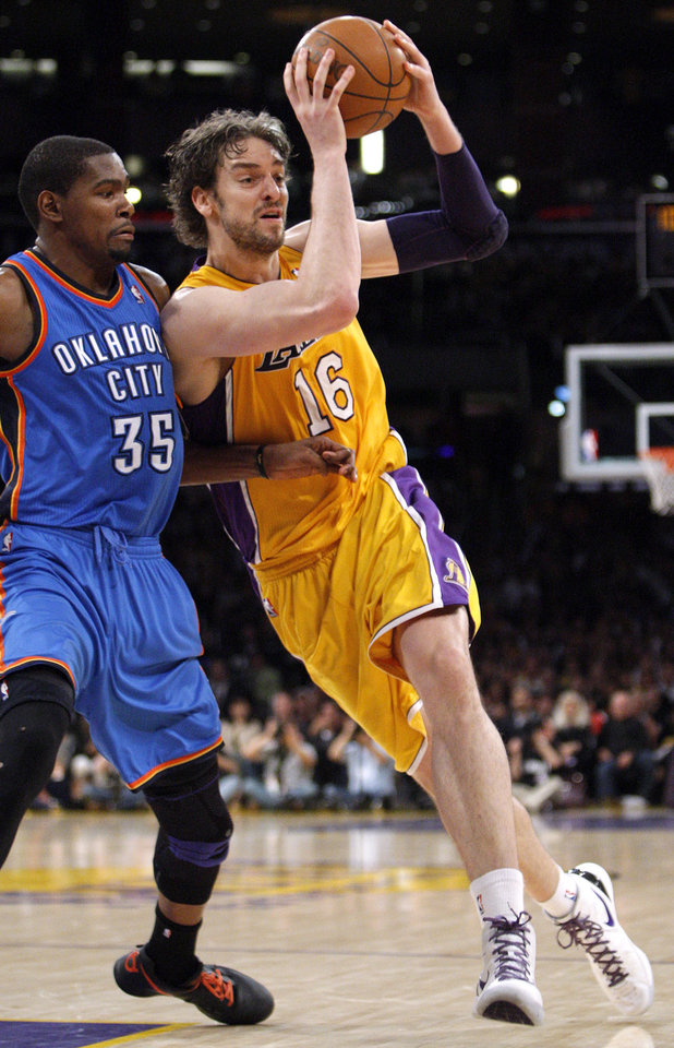 Los Angeles' Pau Gasol (16) tries to get around Oklahoma City's Kevin Durant (35) during Game 4 in the second round of the NBA basketball playoffs between the L.A. Lakers and the Oklahoma City Thunder at the Staples Center in Los Angeles, Saturday, May 19, 2012. Photo by Nate Billings, The Oklahoman
