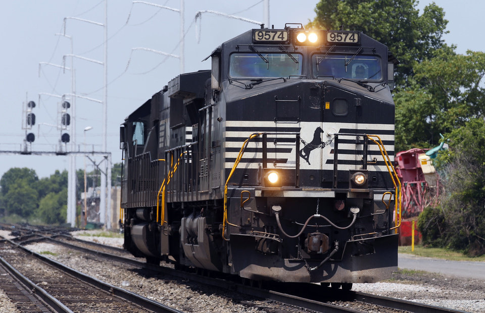Photo - In this June 4, 2014 photo, a Norfolk Southern locomotive moves along the tracks in Norfolk, Va. Norfolk Southern Corp. on Wednesday, July 23, 2014 reported profit that climbed by 21 percent in its second quarter, and topped analysts' expectations. (AP Photo/Steve Helber)