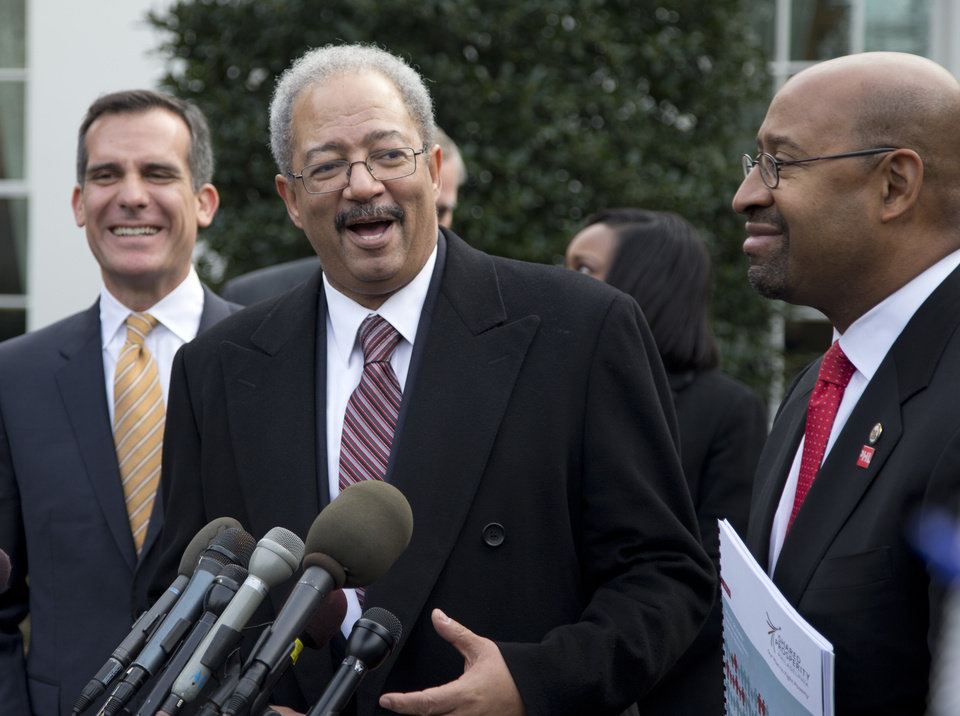 Photo - Rep. Chaka Fattah, D-Pa., center, flanked by Los Angeles Mayor Eric Garcetti, left, and Philadelphia Mayor Michael Nutter, right, speaks outside the White House in Washington, Thursday, Jan. 9, 2014, after an event hosted by President Barack Obama about the Promise Zones Initiative. The Promise Zone Initiative is part of a plan to create a better bargain for the middle-class by partnering with local communities and businesses to create jobs, increase economic security, expand educational opportunities, increase access to quality, affordable housing and improve public safety. (AP Photo/Carolyn Kaster)