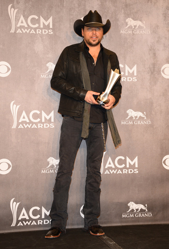 Photo - Jason Aldean poses in the press room with the award for male vocalist of the year at the 49th annual Academy of Country Music Awards at the MGM Grand Garden Arena on Sunday, April 6, 2014, in Las Vegas. (Photo by Al Powers/Powers Imagery/Invision/AP)