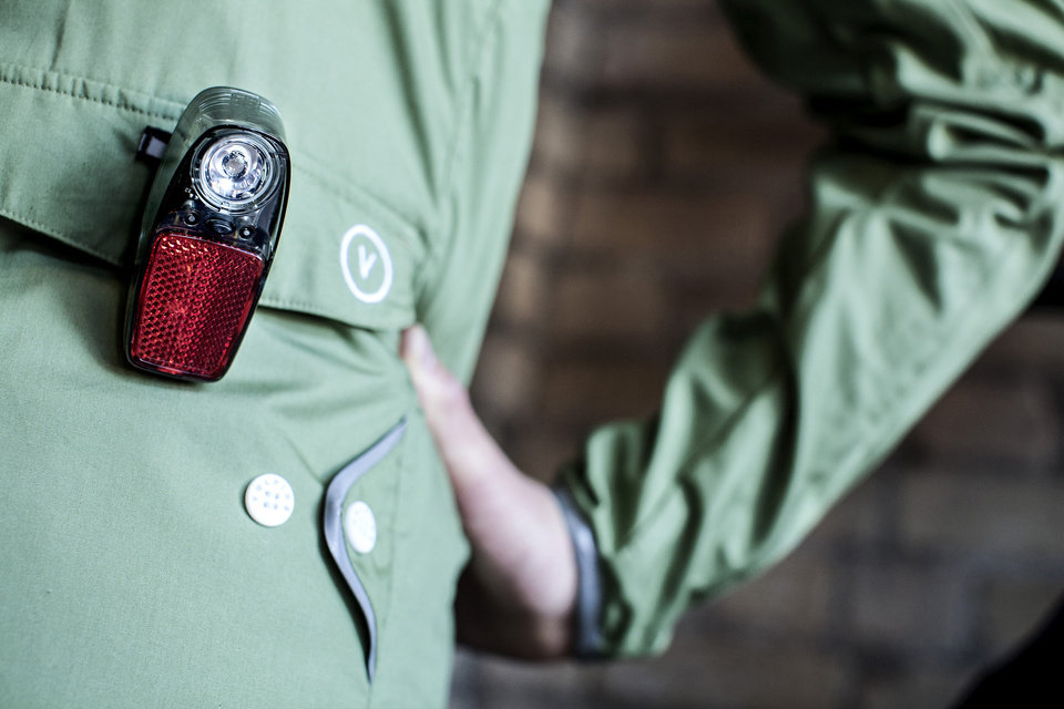 Photo - For those who use bicycles for commuting to work or errands, cycling fashion is going from spandex to multi-functional such as this Vulpine jacket that has a clip for safety lights. (Courtney Perry/Minneapolis Star Tribune/MCT)