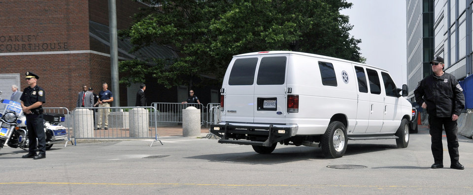 Photo - A U.S. Marshal's van, believed to be carrying Boston Marathon bombing suspect Dzhokhar Tsarnaev, arrives at the federal courthouse for his arraignment Wednesday, July 10, 2013, in Boston. The April 15 attack killed three and wounded more than 260. The 19-year-old Tsarnaev has been charged with using a weapon of mass destruction, and could face the death penalty. (AP Photo/Josh Reynolds)