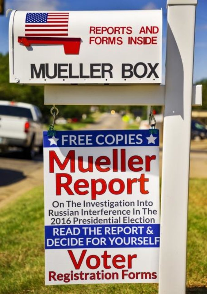 Photo -  The mailbox of Nick and Louise Brooke, where they give away free copies of the Mueller Report, is shown at their home in Oklahoma City. [Chris Landsberger/The Oklahoman]