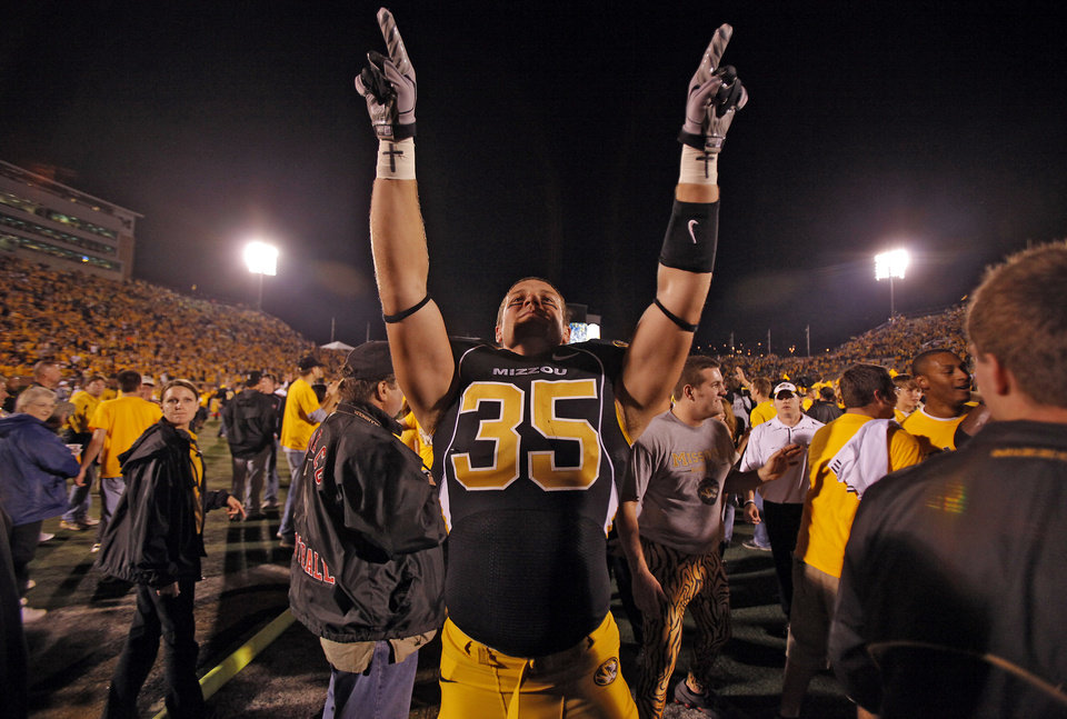 Photo - Missouri's Jeff Gettys (35) celebrates after the college football game between the University of Oklahoma Sooners (OU) and the University of Missouri Tigers (MU) on Saturday, Oct. 23, 2010, in Columbia, Mo. Oklahoma lost the game 36-27. Photo by Chris Landsberger, The Oklahoman