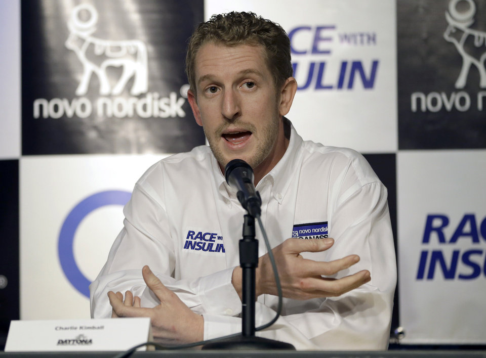 Photo - Charlie Kimball speaks to reporters after it was announced that Chip Ganassi Racing will help with his quest to raise diabetes awareness by partnering with sponsor Novo Nordisk and the Race with Insulin program in all three of its racing series, at Daytona International Speedway on Friday, Feb. 15, 2013, in Daytona Beach, Fla. (AP Photo/John Raoux)