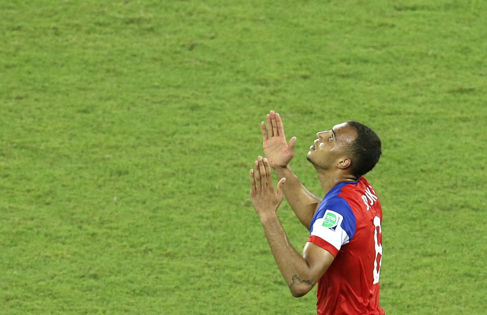 Photo - United States' John Brooks celebrates scoring his side's second goal during the group G World Cup soccer match between Ghana and the United States at the Arena das Dunas in Natal, Brazil, Monday, June 16, 2014. The United States defeated Ghana 2-1. (AP Photo/Hassan Ammar)