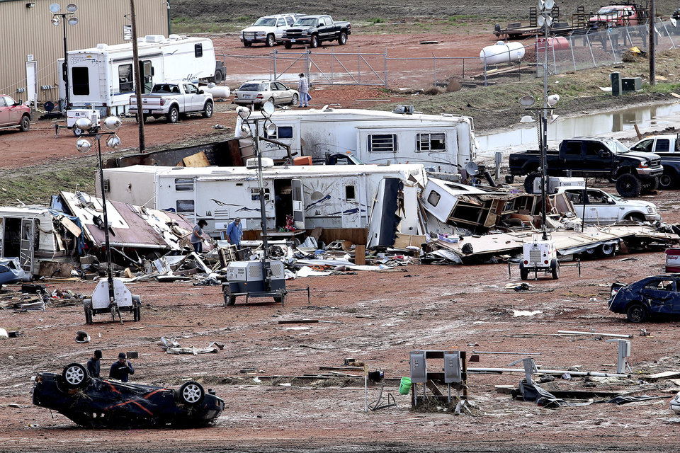 Photo - FILE - In this May 27, 2014 file photo, debris is seen scattered after a tornado hit  in Watford City, N.D., the day before. Authorities say at least eight trailers were destroyed when the twister tore through a camp where oil field workers stay. Nine people were injured, including a 15-year-old girl critically. When waves of workers began spilling into western North Dakota for high-paying oil jobs and nowhere to live, they set their eyes on the rural _ and unregulated _ prairie of McKenzie County. The population was booming so fast that no one knew how many people were in the county, so local officials pushed through ordinances that are now being credited in part with helping emergency workers during the severe storm that brought only the 14th tornado to the county in 65 years. (AP Photo/Williston Herald, Tyler Bell, File)