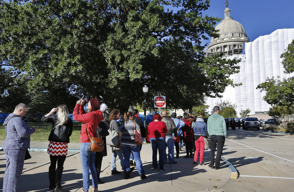 Photo - People wait in line to enter the east side of the Capitol. Advocates for mental health care descended upon the state Capitol Tuesday morning, Oct. 24, 2017, to demand that lawmakers come up with a budget solution that includes funding for mental health services. Photo by Jim Beckel, The Oklahoman