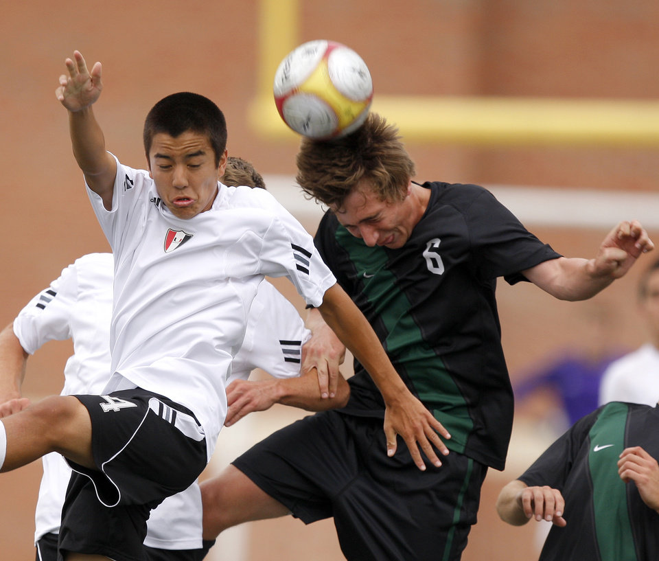 Tulsa Union's Van Horne, left, and Norman North's Michael Henke go for the ball during the boys 6A state championship soccer game in Newcastle, Okla., Saturday, May 12, 2012. Photo by Bryan Terry, The Oklahoman