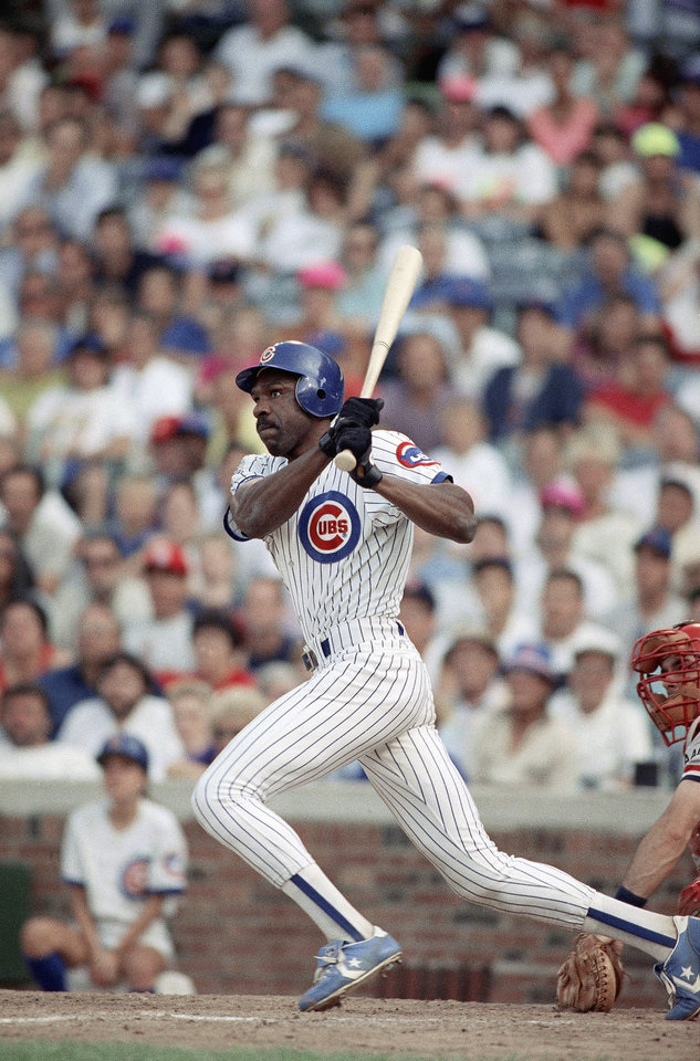Photo - MAJOR LEAGUE BASEBALL: Chicago Cubs? Andre Dawson singles in the 15th inning driving in the game winning run against the St. Louis Cardinals, Wednesday, August 8, 1990 in Chicago. With the bases loaded and two outs, Dawson singled, giving a 4-3 victory for the Cubs. (AP Photo/John Swart) ORG XMIT: APHS230506