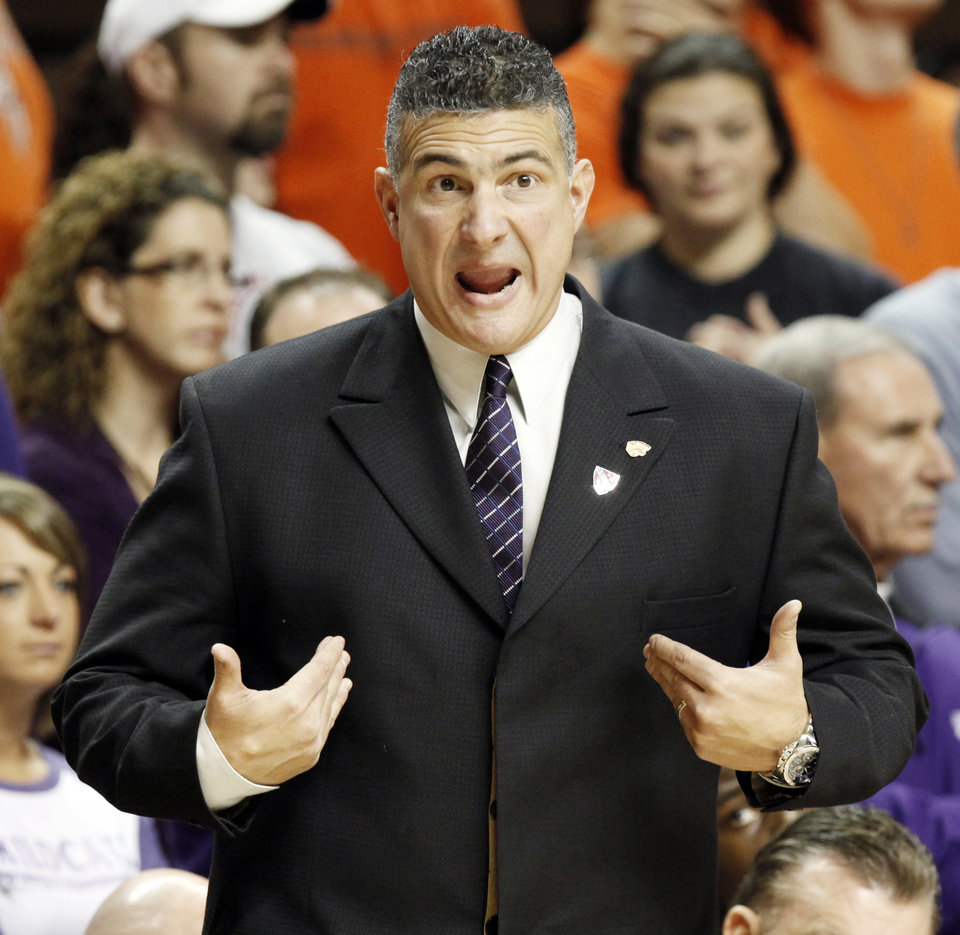 Photo - KSU head coach Frank Martin talks to an official during the men's college basketball game between Oklahoma State University (OSU) and Kansas State University (KSU) at Gallagher-Iba Arena in Stillwater, Okla., Saturday, January 8, 2011. Photo by Nate Billings, The Oklahoman