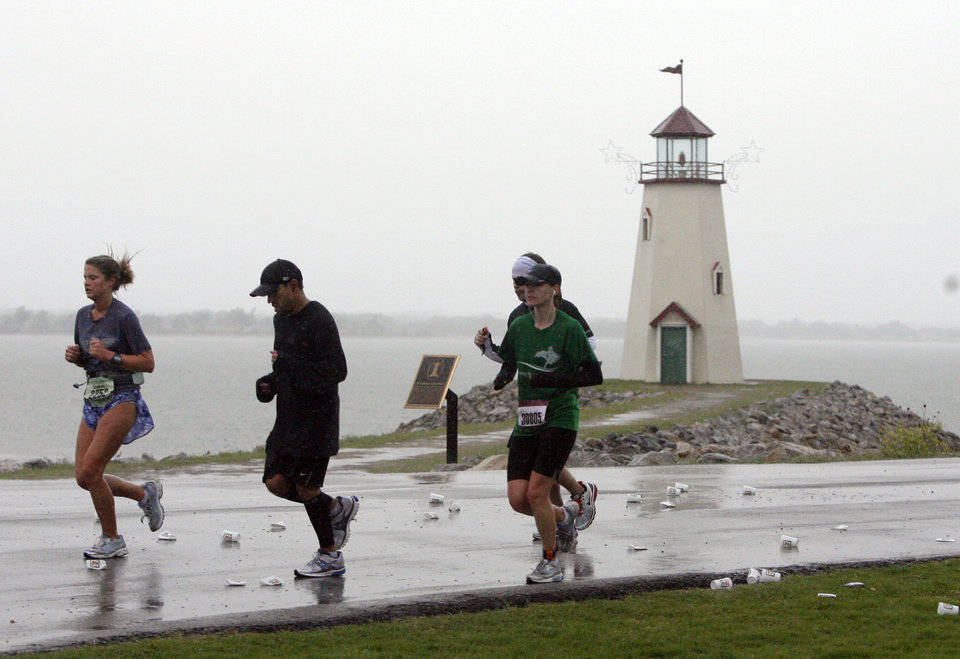 Photo - Marathoners run past the light house at Lake Hefner during the Oklahoma City Memorial Marathon, Sunday, May 1, 2010, in Oklahoma City. Photo by Sarah Phipps, The Oklahoman