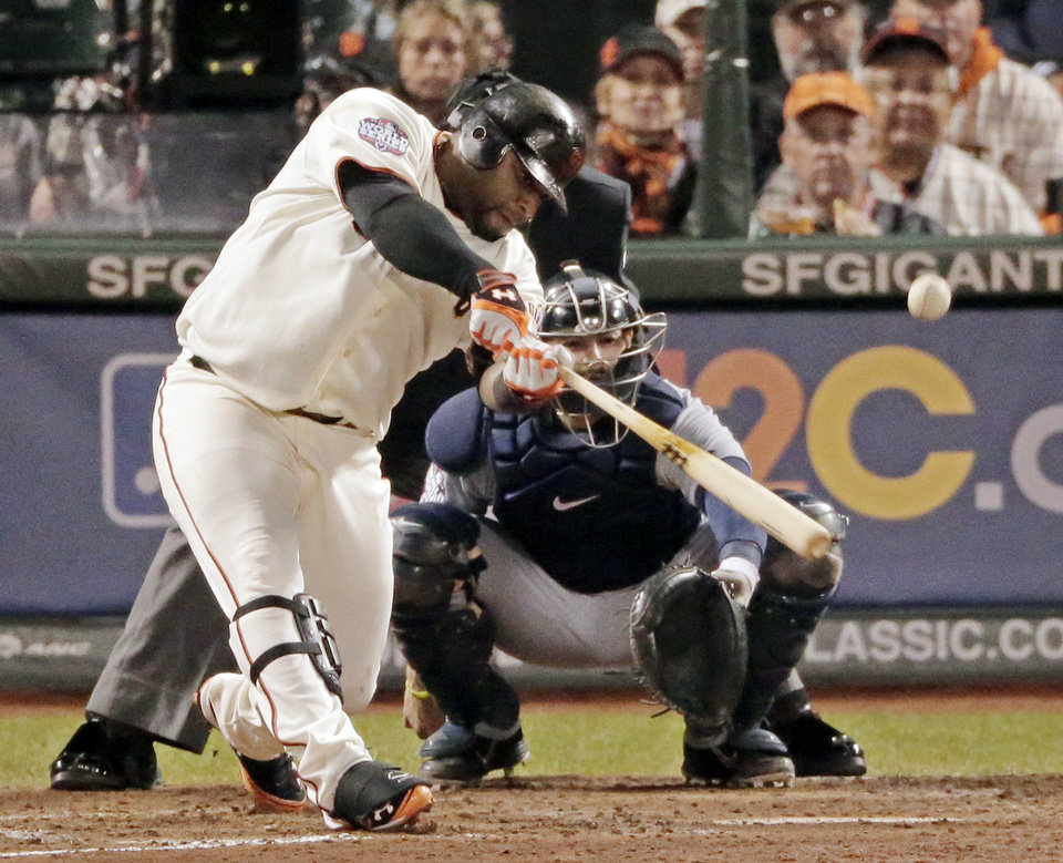 Photo -   CORRECTS INNING TO FIFTH, NOT SIXTH - San Francisco Giants' Pablo Sandoval hits a solo home run in the fifth inning of Game 1 of baseball's World Series against the Detroit Tigers, Wednesday, Oct. 24, 2012, in San Francisco. (AP Photo/Charlie Riedel)