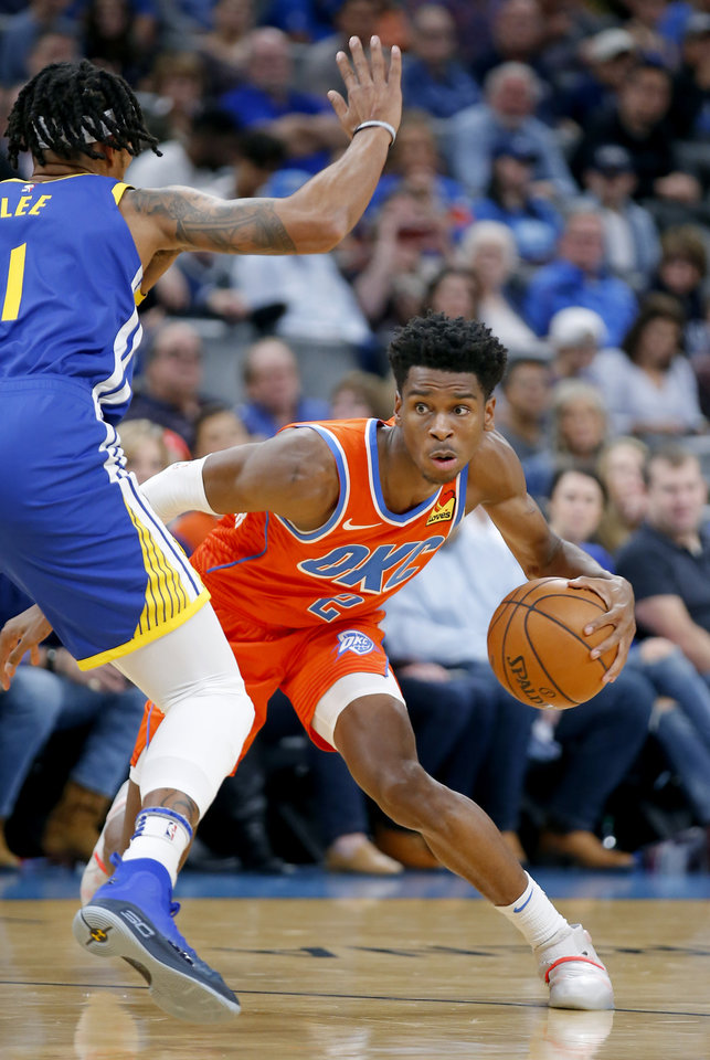 Photo - Oklahoma City's Shai Gilgeous-Alexander (2) looks to get around Golden State's Damion Lee (1) during the NBA game between the Oklahoma City Thunder and Golden State Warriors at Chesapeake Energy Arena,  Sunday, Oct. 27, 2019. Thunder won 120-92.[Sarah Phipps/The Oklahoman]