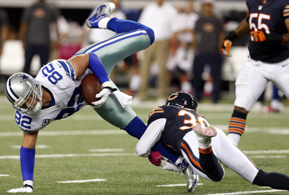 Photo -   Chicago Bears cornerback D.J. Moore (30) tackles Dallas Cowboys tight end Jason Witten (82) during the second half of an NFL football game, Monday, Oct. 1, 2012, in Arlington, Texas. (AP Photo/Sharon Ellman)