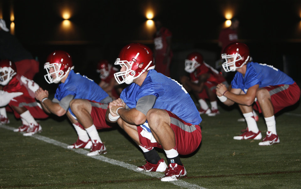 Sooner Players warm up at pre-dawn drills for the University of Oklahoma (OU) in Norman, Okla., Friday, Aug. 2, 2013. Photo by Steve Sisney, The Oklahoman