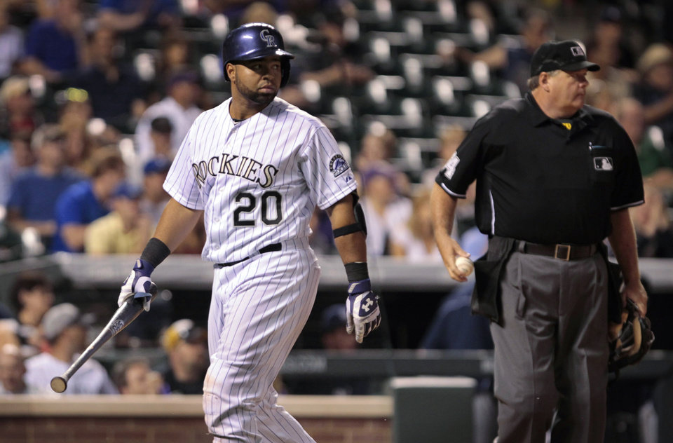 Photo - Colorado Rockies' Wilin Rosario (20) walks to the dugout after striking out against the Milwaukee Brewers to end the eighth inning with the potential tying run for the Rockies on base during a baseball game in Denver on Friday, June 20, 2014.(AP Photo/Joe Mahoney)